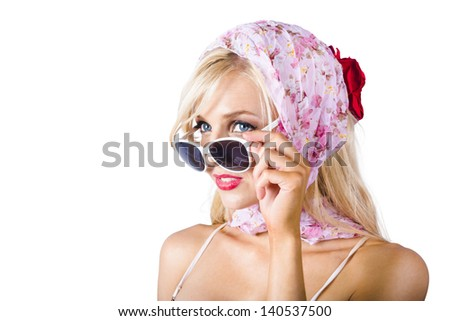 Classy young blond woman in pink headscarf and sunglasses, white background - stock photo