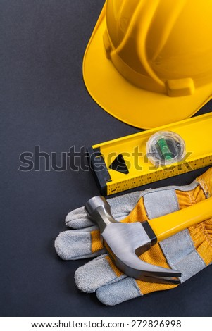 claw hammer protective work glove level helmet on black background  - stock photo