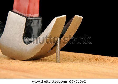 Claw hammer pulling out nail