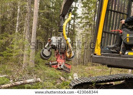 Claw manipulator of big industrial harvester - stock photo