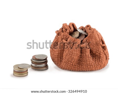 Clay bag with money and column of coins isolated on a white background.  Investment or growth concept  - stock photo