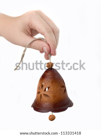 clay bell in his hand - stock photo