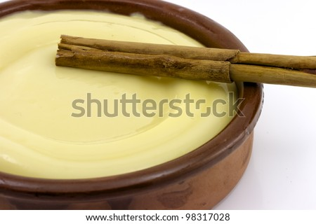 clay bowl, tasty dessert custard and cinnamon, detail - stock photo