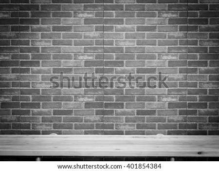 Clay brick texture of wall with wooden board panel on top table.Pattern texture for background.