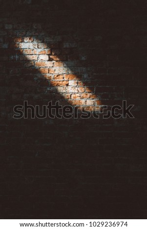 Clay brick wall with light streak - wall pattern