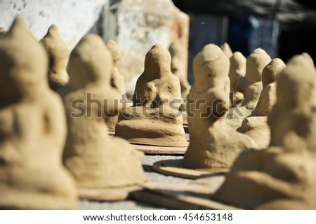 Clay buddha statue in processing of Myanmar - stock photo