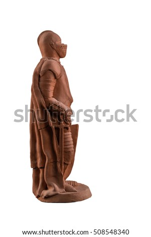 clay ceramic statue of a knight on a white background