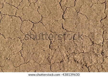 Clay cracked texture. Equal layer of compacted clay soil with cracks. - stock photo