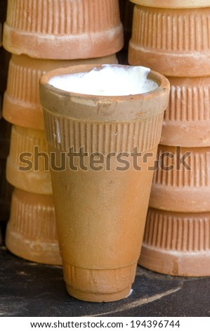 Clay cups containing Indian milk curd yoghurt or lassi - stock photo
