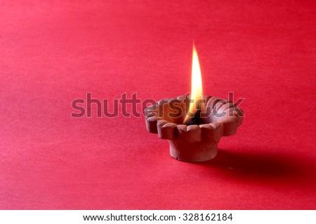 Clay diya lamps lit during diwali celebration. Greetings Card Design Indian Hindu Light Festival called Diwali - stock photo