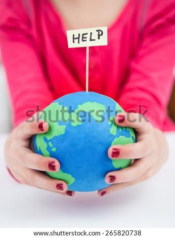 clay earth globe, saving the earth - help - stock photo