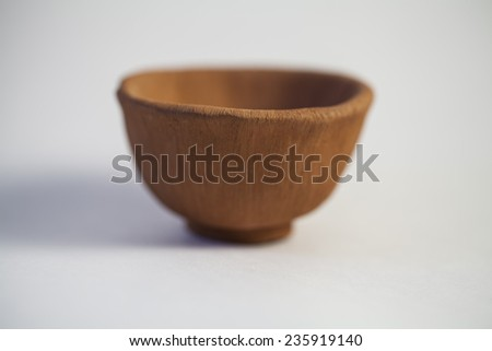 Clay hand made brown bowl -  asian craft - stock photo