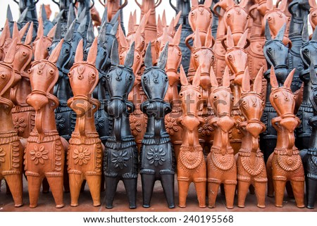 Clay horses in black and red from Bankura in West Bengal - stock photo