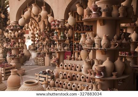 Clay jars at the rural arabic market - stock photo