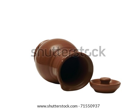 Clay jug on a white background