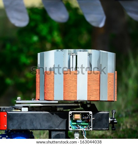 clay pigeon ready for launch in sunny day - stock photo