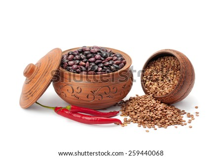 clay pots legumes and chili peppers isolated on white background - stock photo