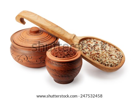 clay pots, wooden spoon and wild rice isolated on white background