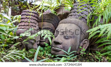 Clay Sculpture Buddha Heads in the Garden