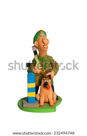 Clay statuette a border guard with dog near frontier post isolated on white background - stock photo