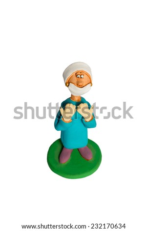 Clay statuette a woman surgeon with the lifted gloved hands in a mask isolated on a white background - stock photo