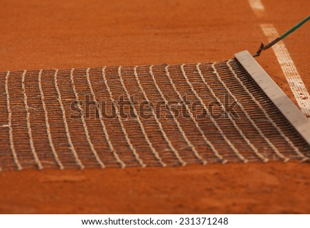 Clay tennis court harvest event. Rolland Garros tennis championship. French open - stock photo