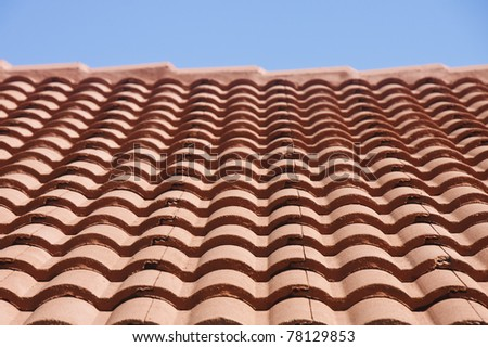 Clay Tile Roof Under a Blue Sky