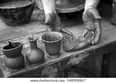 Clay worker, craftsman detail of a street worker, potter