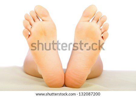 Clean and healthy woman feet isolated on white.
