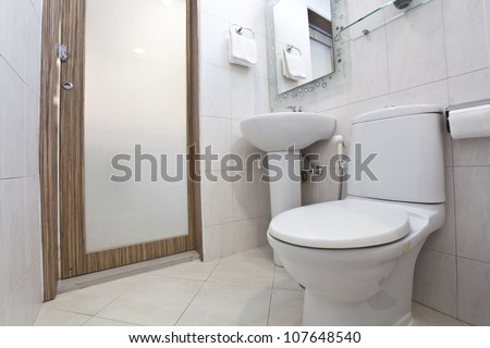 Clean and white water closet in a bathroom - stock photo