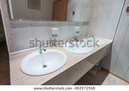 clean bathroom with sinks in the hostel