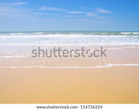 Clean beach with blue sky - stock photo