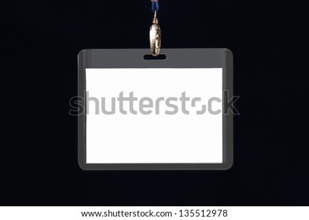 clean breast plastic name tag on the metal clasp, photo on black background.