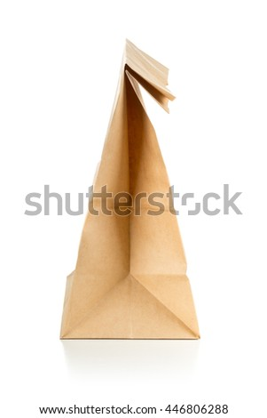 Clean brown paper doggy bag from recycled paper on white background - stock photo