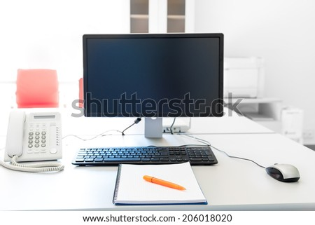 clean desktop manager with a computer - stock photo