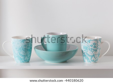 Clean dishes on wooden shelf - stock photo