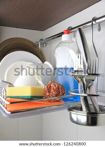 clean dishware, detergent and sponge - stock photo