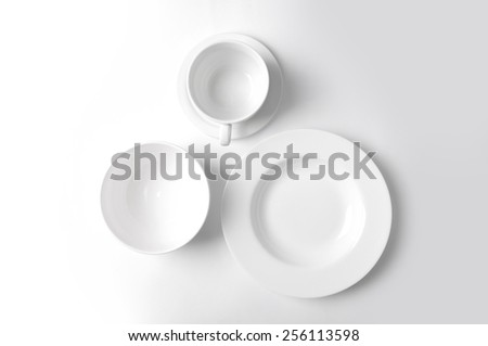 Clean dishware on white - stock photo