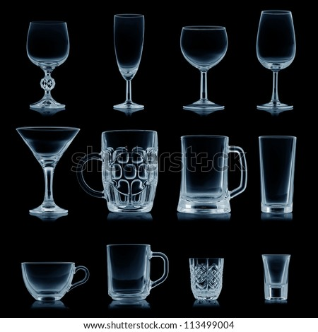 Clean empty glassware collection isolated on black - stock photo