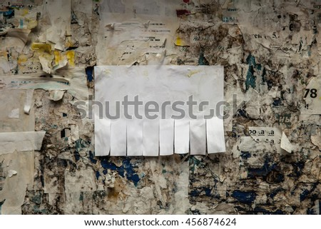Clean empty paper ads pasted on street bulletin board. Background template to add text - stock photo