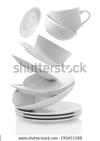 Clean empty plates and cups isolated on white  - stock photo