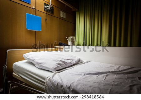 Clean empty sickbed in a hospital ward at night - stock photo
