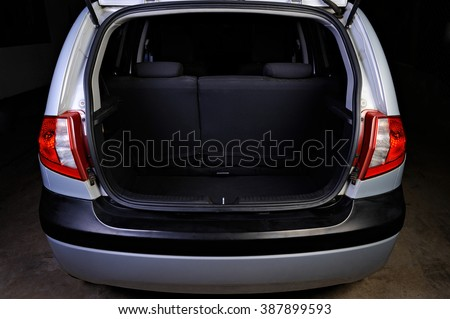 clean empty trunk of silver hatchback isolated on black