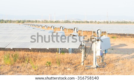 Clean Energy, rows of a photovoltaic panels with Solar Tracker system - stock photo