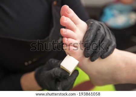 clean foot with white bar of pumice  - stock photo