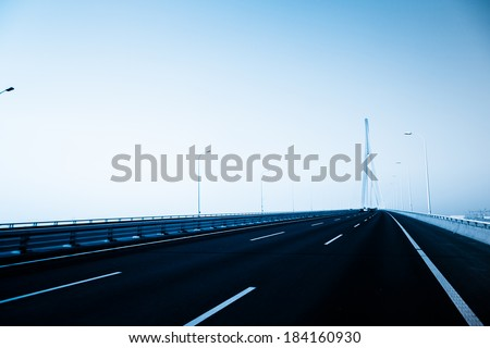 clean freeway with modern bridge of china. - stock photo