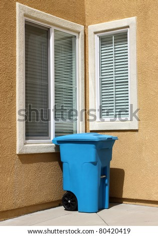 Clean garbage can in urban house - stock photo