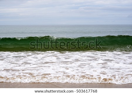 clean green waves breaking on the beach in ballybunion county kerry ireland