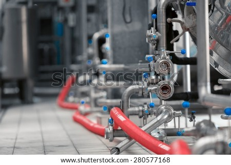 Clean high quality pipeline in industrial interior - stock photo