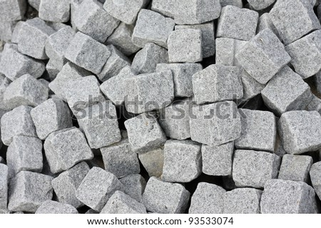 Clean isolation of a bunch of cobblestones. - stock photo
